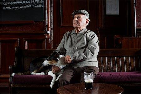 Man With Dog in Pub Stock Photo - Premium Royalty-Free, Code: 600-01123757