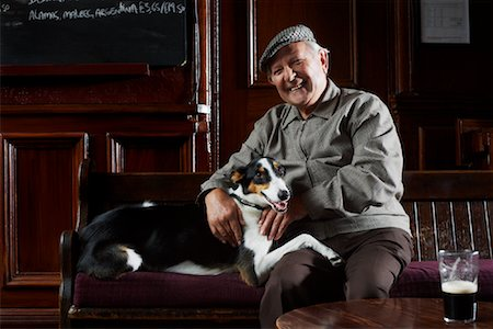Man With Dog in Pub Stock Photo - Premium Royalty-Free, Code: 600-01123758