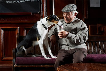 Man With Dog in Pub Stock Photo - Premium Royalty-Free, Code: 600-01123759