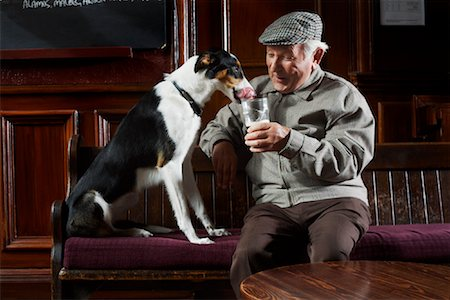 Man With Dog in Pub Stock Photo - Premium Royalty-Free, Code: 600-01123760