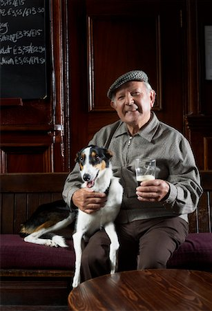 Man With Dog in Pub Stock Photo - Premium Royalty-Free, Code: 600-01123761