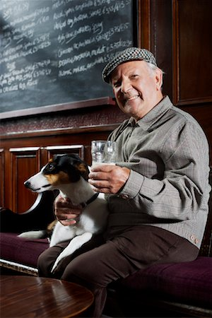 Man With Dog in Pub Stock Photo - Premium Royalty-Free, Code: 600-01123762