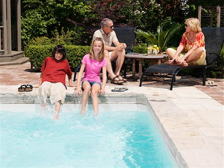 Family Pool Side Stock Photo - Premium Royalty-Free, Code: 600-01164437