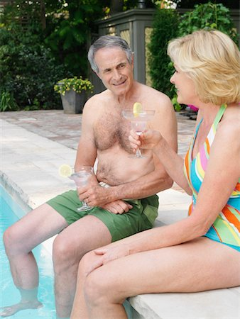 seniors woman in swimsuit - Couple Pool Side Stock Photo - Premium Royalty-Free, Code: 600-01164455