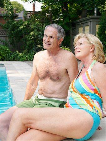 seniors woman in swimsuit - Couple Pool Side Stock Photo - Premium Royalty-Free, Code: 600-01164457