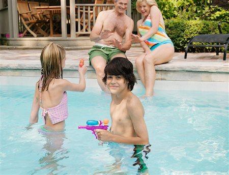 Family Pool Side Stock Photo - Premium Royalty-Free, Code: 600-01164461