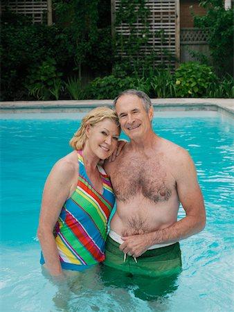 seniors woman in swimsuit - Couple in Swimming Pool Stock Photo - Premium Royalty-Free, Code: 600-01164474
