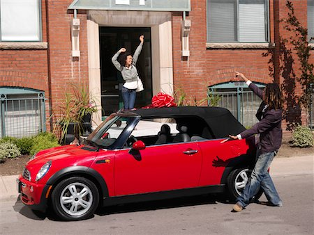 Man Giving Woman New Car Stock Photo - Premium Royalty-Free, Code: 600-01164721