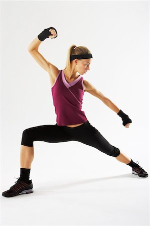 Woman Exercising Stock Photo - Premium Royalty-Free, Code: 600-01163677