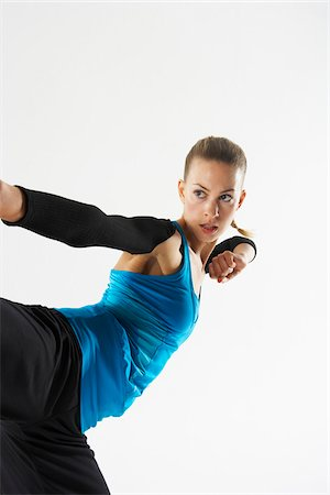 stretch - Woman Exercising Stock Photo - Premium Royalty-Free, Code: 600-01163700