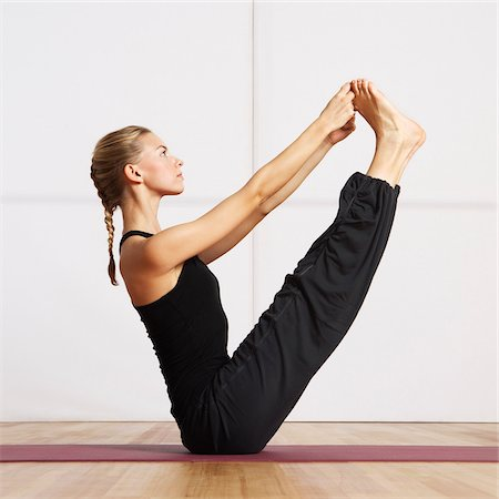 Woman Practicing Yoga Stock Photo - Premium Royalty-Free, Code: 600-01163761