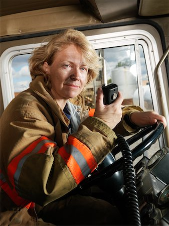 female truck driver - Firefighter in Fire Truck Stock Photo - Premium Royalty-Free, Code: 600-01172254