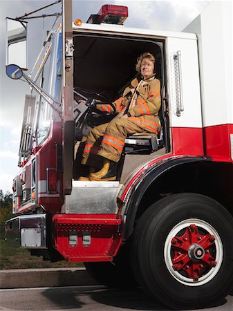 female truck driver - Firefighter in Fire Truck Stock Photo - Premium Royalty-Free, Code: 600-01172252