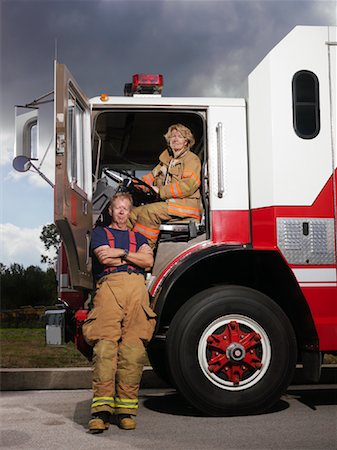 female truck driver - Firefighters and Fire Truck Stock Photo - Premium Royalty-Free, Code: 600-01172253