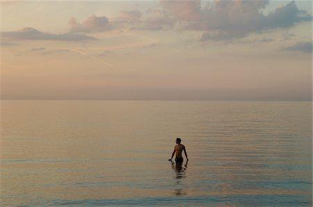 Man Standing in Ocean Stock Photo - Premium Royalty-Free, Code: 600-01173584