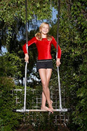 preteen girl feet - Girl Doing Gymnastics Outdoors Stock Photo - Premium Royalty-Free, Code: 600-01173704