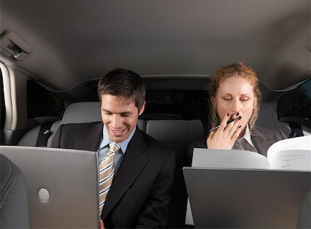 Businesspeople Working in Back of Car Stock Photo - Premium Royalty-Free, Code: 600-01173944