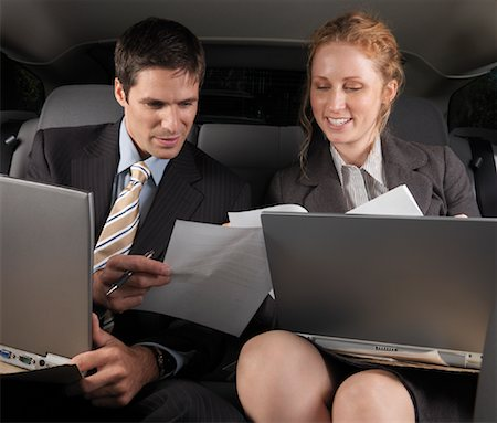 Businesspeople Working in Back of Car Stock Photo - Premium Royalty-Free, Code: 600-01173945