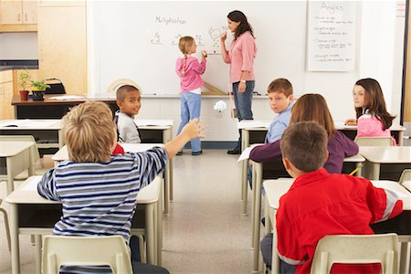 photo of class with misbehaving kids - Students and Teacher in Classroom Stock Photo - Premium Royalty-Free, Code: 600-01184690