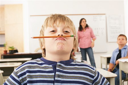 Student Goofing Around in Classroom Stock Photo - Premium Royalty-Free, Code: 600-01184713
