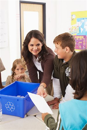 passing of papers in the classroom - Students and Teacher in Classroom Stock Photo - Premium Royalty-Free, Code: 600-01184741