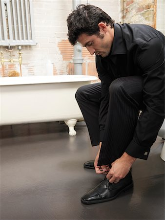 Man Tying Shoes Stock Photo - Premium Royalty-Free, Code: 600-01184955
