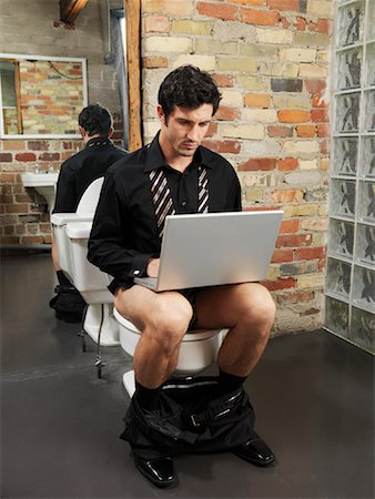 Man Sitting on Toilet Using Laptop Computer Stock Photo - Premium Royalty-Free, Code: 600-01184958