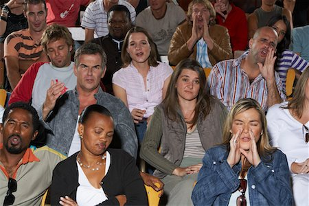 front row seat - Annoyed People in Auditorium Seats Stock Photo - Premium Royalty-Free, Code: 600-01195617