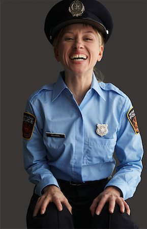 female police officer happy - Portrait of Police Officer Stock Photo - Premium Royalty-Free, Code: 600-01195823