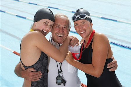 seniors and swim cap - Swimmers With Coach Stock Photo - Premium Royalty-Free, Code: 600-01196706