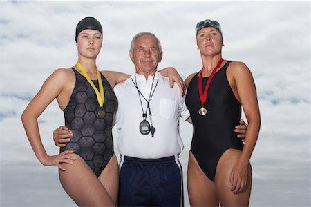 seniors and swim cap - Swimmers With Coach Stock Photo - Premium Royalty-Free, Code: 600-01196707