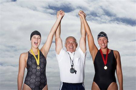 seniors and swim cap - Swimmers Cheering With Coach Stock Photo - Premium Royalty-Free, Code: 600-01196709