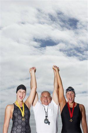 seniors and swim cap - Swimmers Cheering With Coach Stock Photo - Premium Royalty-Free, Code: 600-01196710