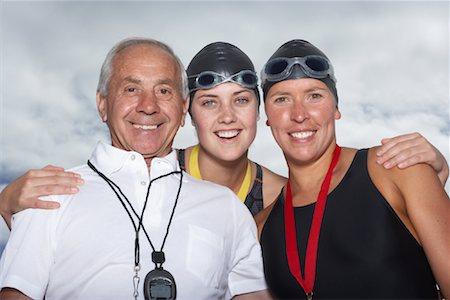 seniors and swim cap - Portrait of Swimmers With Coach Stock Photo - Premium Royalty-Free, Code: 600-01196711