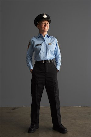 female police officer happy - Portrait of Police Officer Stock Photo - Premium Royalty-Free, Code: 600-01199093