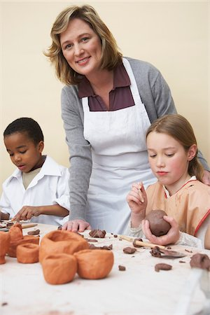 Children and Instructor in Pottery Studio Stock Photo - Premium Royalty-Free, Code: 600-01200410