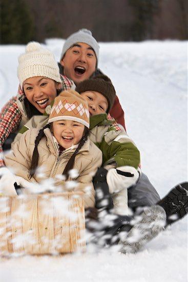 Family on Toboggan, Whistler, British Columbia, Canada Stock Photo - Premium Royalty-Free, Artist: Masterfile, Image code: 600-01224171