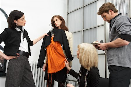 Designers Discussing Outfit Stock Photo - Premium Royalty-Free, Code: 600-01224434
