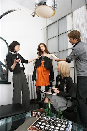 Designers Discussing Outfit Stock Photo - Premium Royalty-Free, Code: 600-01224433