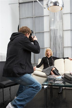 Photographer Taking Picture of Businesswoman Stock Photo - Premium Royalty-Free, Code: 600-01224440