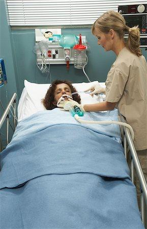 Nurse Tending to Patient Stock Photo - Premium Royalty-Free, Code: 600-01223652