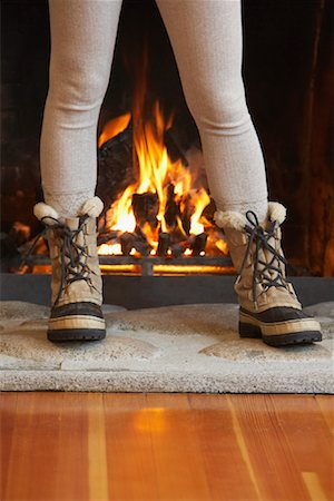 Woman Standing in Front of Fireplace Stock Photo - Premium Royalty-Free, Code: 600-01235296
