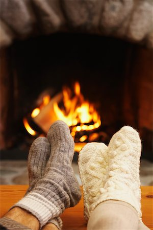 Feet in Front of Fireplace Stock Photo - Premium Royalty-Free, Code: 600-01235291