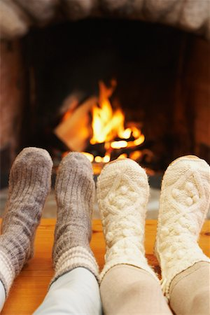 Feet in Front of Fireplace Stock Photo - Premium Royalty-Free, Code: 600-01235292