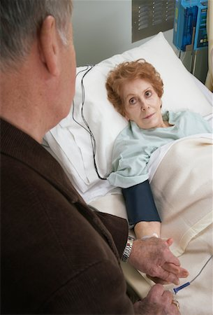Husband Visiting Wife in Hospital Stock Photo - Premium Royalty-Free, Code: 600-01235407