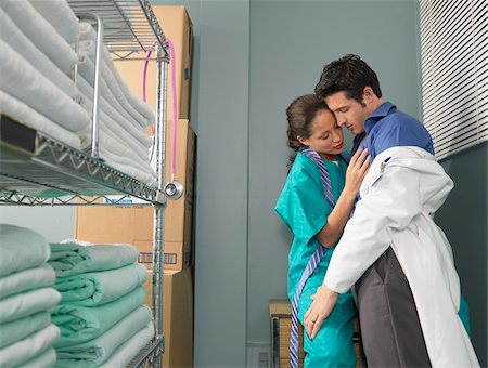 sexually aroused woman - Doctor and Nurse Kissing in Supply Room Stock Photo - Premium Royalty-Free, Code: 600-01236136