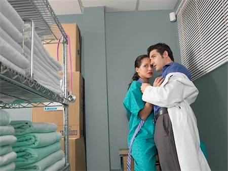 sexually aroused woman - Doctor and Nurse Kissing in Supply Room Stock Photo - Premium Royalty-Free, Code: 600-01236137