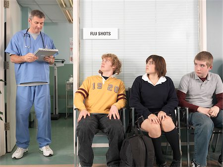 doctor in waiting room - Doctor Calling Next Patient Stock Photo - Premium Royalty-Free, Code: 600-01236179