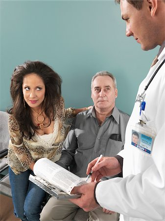 Woman Flirting With Doctor Stock Photo - Premium Royalty-Free, Code: 600-01236172