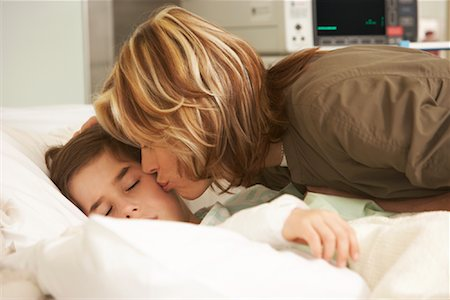 people kissing little boys - Mother Kissing Son in Hospital Stock Photo - Premium Royalty-Free, Code: 600-01236210